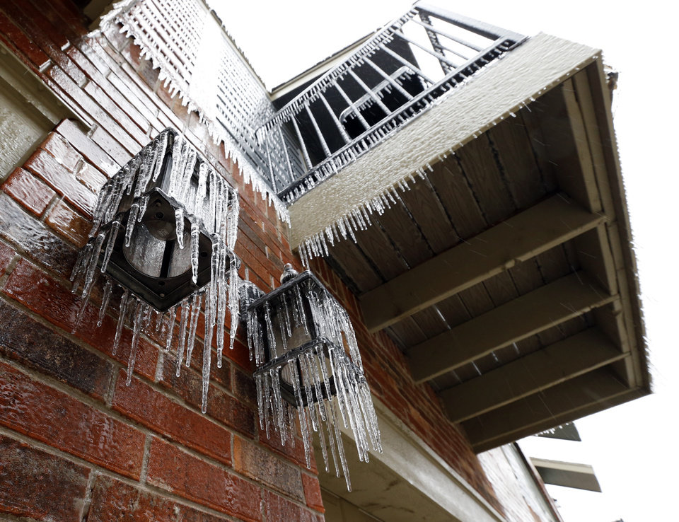 Photo - A thick coat of ice covers exposed surfaces on the southeast side of the city on Saturday, Dec. 21, 2013 in Norman, Okla.  Photo by Steve Sisney, The Oklahoman