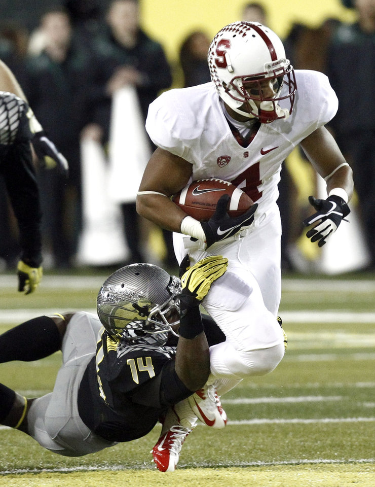 Stanford receiver Drew Terell, right, is tackled by Oregon defender Ifo Ekpre-Olomu during the first half of their NCAA college football game in Eugene, Ore., Saturday, Nov. 17, 2012. (AP Photo/Don Ryan)