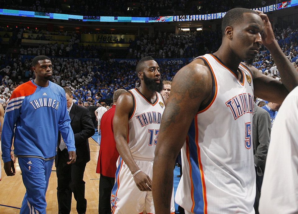 Oklahoma City's Kendrick Perkins (5), James Harden (13) and Nazr Mohammed (8) walk of the court following Game 2 of the NBA Finals between the Oklahoma City Thunder and the Miami Heat at Chesapeake Energy Arena in Oklahoma City, Thursday, June 14, 2012. Photo by Sarah Phipps, The Oklahoman