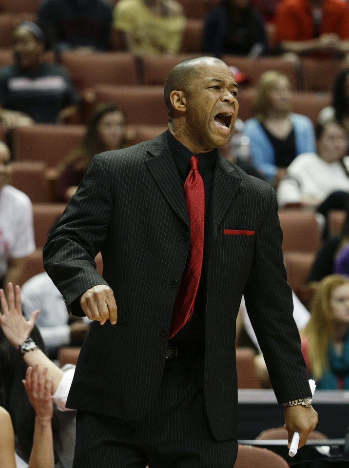Photo - Cal State Northridge head coach Jason Flowers directs his team during the first half of an NCAA college basketball game against Cal Poly in the final of the Big West Conference tournament, on Saturday, March 15, 2014, in Anaheim, Calif. (AP Photo/Jae C. Hong)