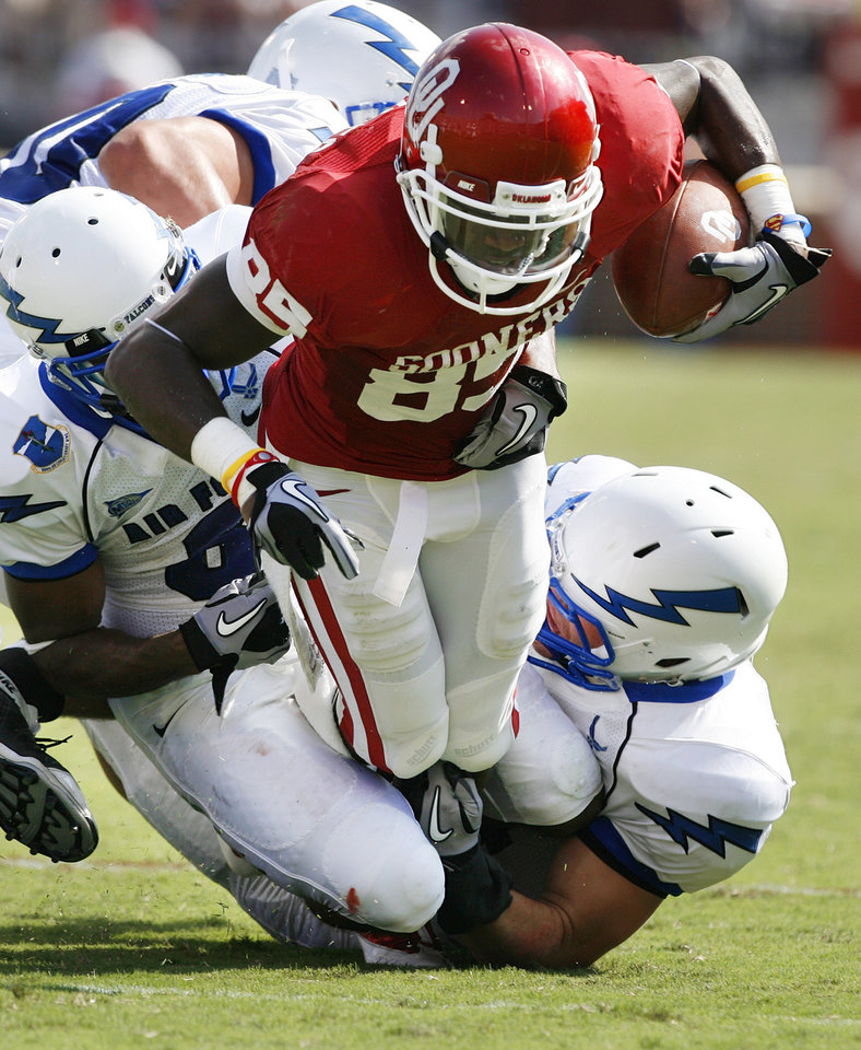 Ryan Broyles (85) is brought down after a catch during the first half of the college football game between the University of Oklahoma Sooners (OU) and the Air Force Falcons at Gaylord Family-Oklahoma Memorial Stadium on Saturday, Sept. 18, 2010, in Norman, Okla. Photo by Steve Sisney, The Oklahoman