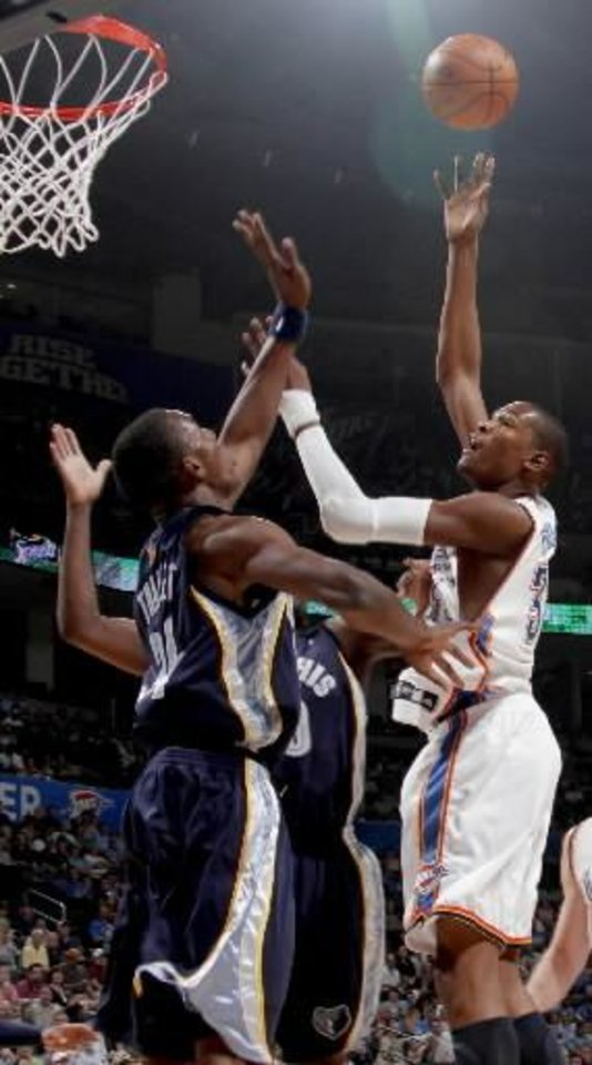 Oklahoma City\'s Kevin Durant puts up a shot over Hasheem Thabeet of Memphis during the NBA basketball game between the Oklahoma City Thunder and the Memphis Grizzlies at the Ford Center in Oklahoma City on Wednesday, April 14, 2010. Photo by Bryan Terry