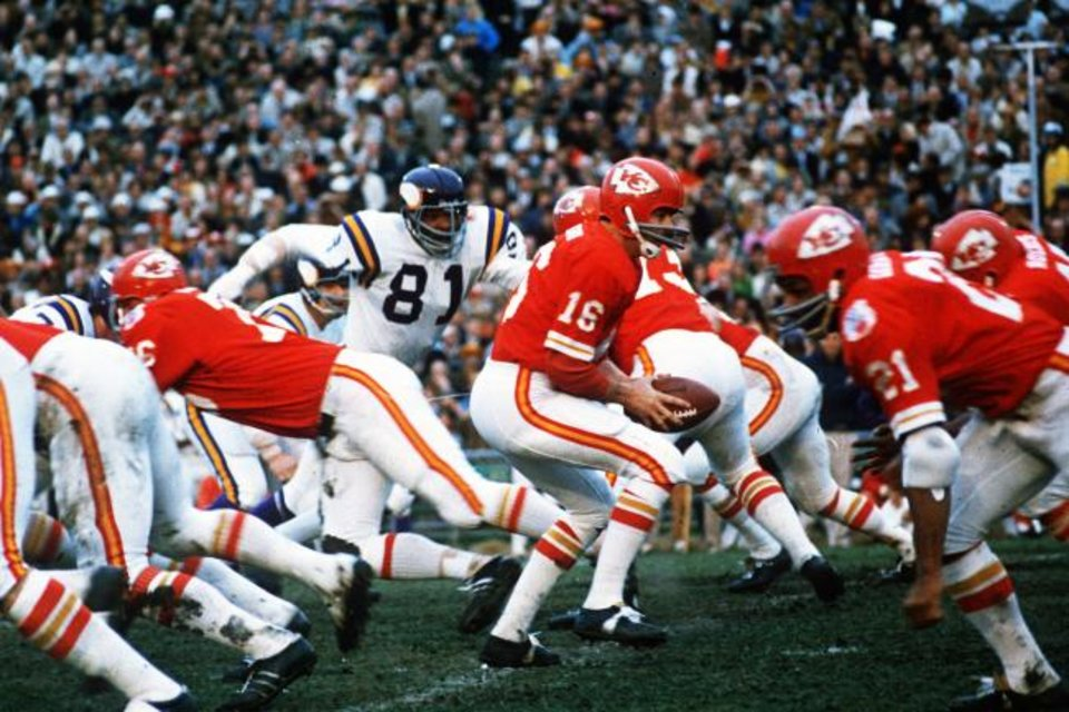 Photo -  In this Jan. 11, 1970, file photo, Kansas City Chiefs quarterback Len Dawson (16) turns around to hand the ball off to running back Mike Garrett (21) during Super Bowl IV in New Orleans.  As the Chiefs prepare to play the San Francisco 49ers on Sunday,  many members of the 1970 Super Bowl champions never lived to see the Chiefs return to the championship game. [AP Photo/File]