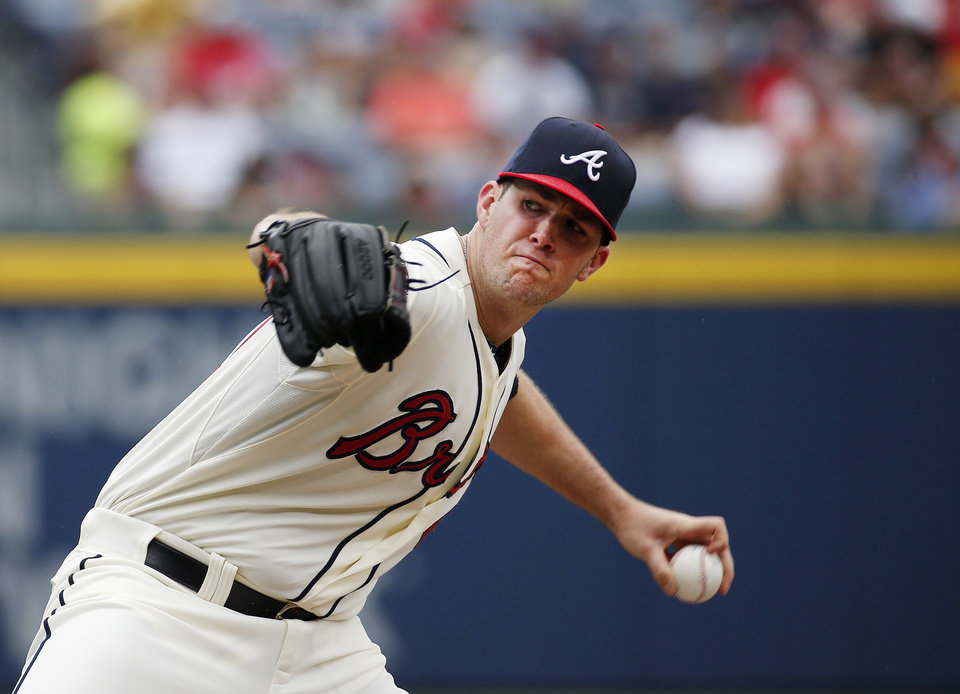 Photo - Atlanta Braves relief pitcher Alex Wood  works in the first inning of a baseball game  against the Philadelphia Phillies in Atlanta, Sunday, July 20, 2014.(AP Photo/John Bazemore)