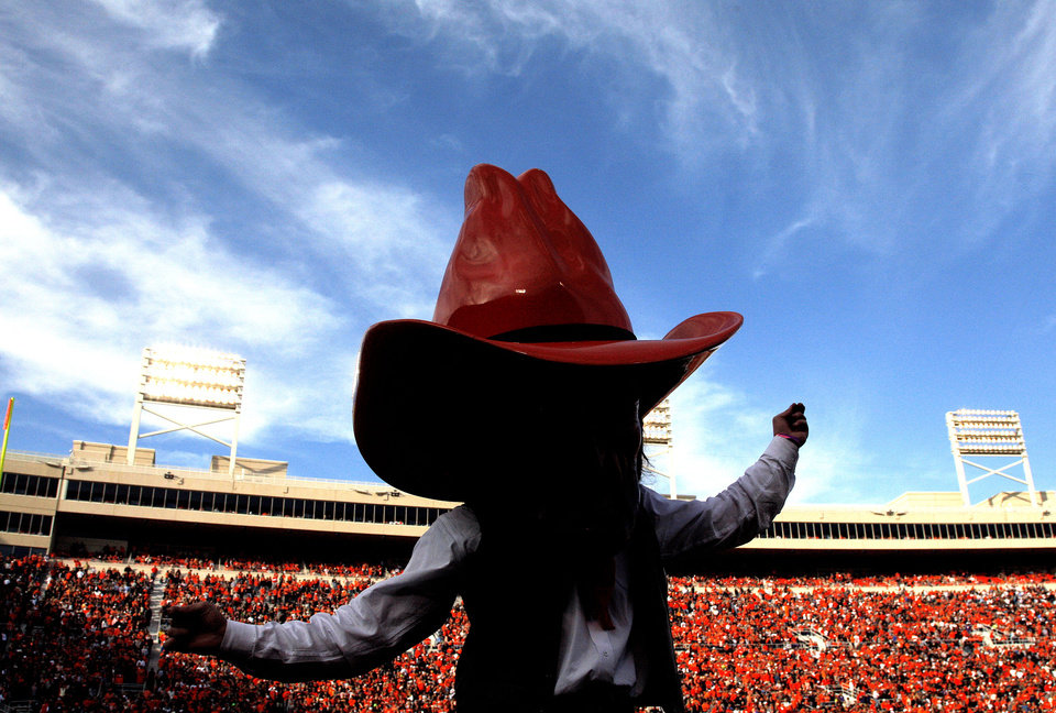 Photo - Pistol Pete dances during a college football game between Oklahoma State University (OSU) and Texas Christian University (TCU) at Boone Pickens Stadium in Stillwater, Okla., Saturday, Oct. 27, 2012. Photo by Sarah Phipps, The Oklahoman