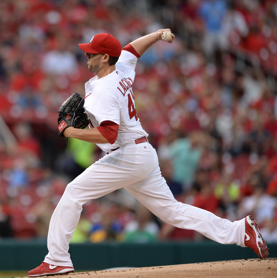 Photo - St. Louis Cardinals' starting pitcher John Lackey (41) throws against the San Diego Padres' in the first inning in a baseball game, Thursday, Aug. 14, 2014, at Busch Stadium in St. Louis. (AP Photo/Bill Boyce)