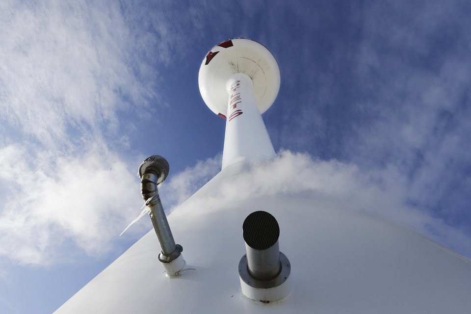 Photo - Condensation floats around the base of a water tower in Gretna, Neb., Friday, Dec. 6, 2013, as the temperature registered 10 degrees and the wind chill was -7 Fahrenheit. A cold snap enveloped the mid-section of the nation. (AP Photo/Nati Harnik)