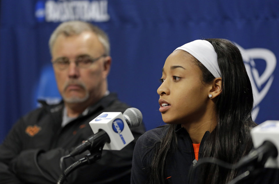 Photo - Oklahoma State guard Tiffany Bias, right, answers a question as head coach Jim Littell sits near during an NCAA college basketball tournament news conference in West Lafayette, Ind., Sunday, March 23, 2014. Oklahoma State faces Purdue in a second round game on Monday. (AP Photo/Michael Conroy)