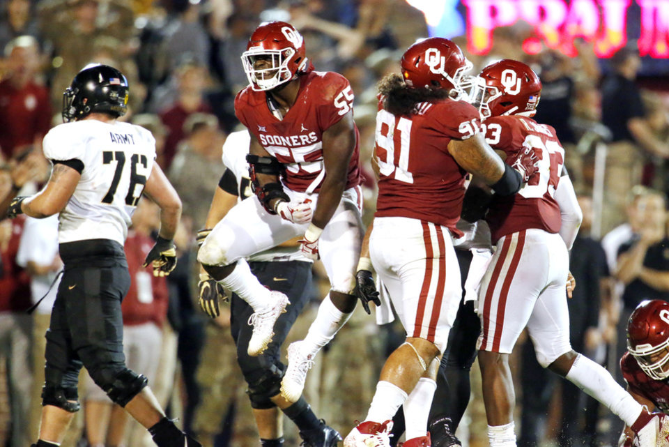 Photo - Oklahoma's Kenneth Mann (55) celebrates an Oklahoma interception on Army's last regular game possession during a college football game in which the University of Oklahoma Sooners (OU) defeated the Army Black Knights 28-21 at Gaylord Family-Oklahoma Memorial Stadium in Norman, Okla., on Saturday, Sept. 22, 2018. Photo by Steve Sisney, The Oklahoman