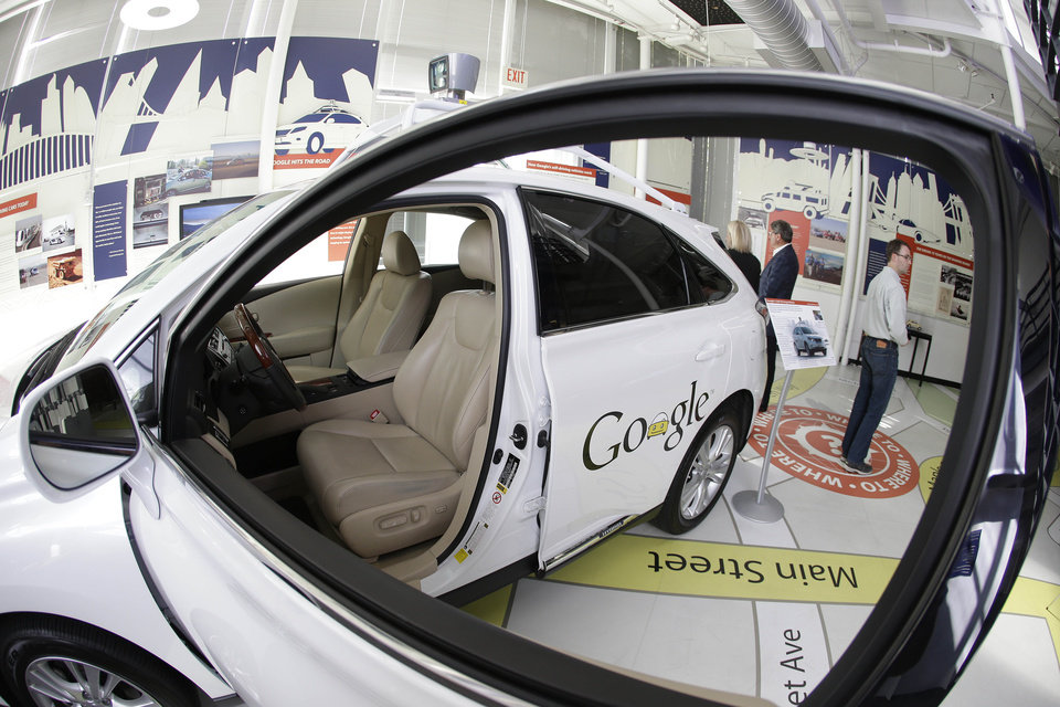Photo - In this photo taken Wednesday, May 14, 2014, a Google self-driving car is shown in an exhibit at the Computer History Museum in Mountain View, Calif. Four years ago, the Google team developing cars which can drive themselves became convinced that, sooner than later, the technology would be ready for the masses. There was just one problem: Driverless cars almost certainly were illegal.(AP Photo/Eric Risberg)
