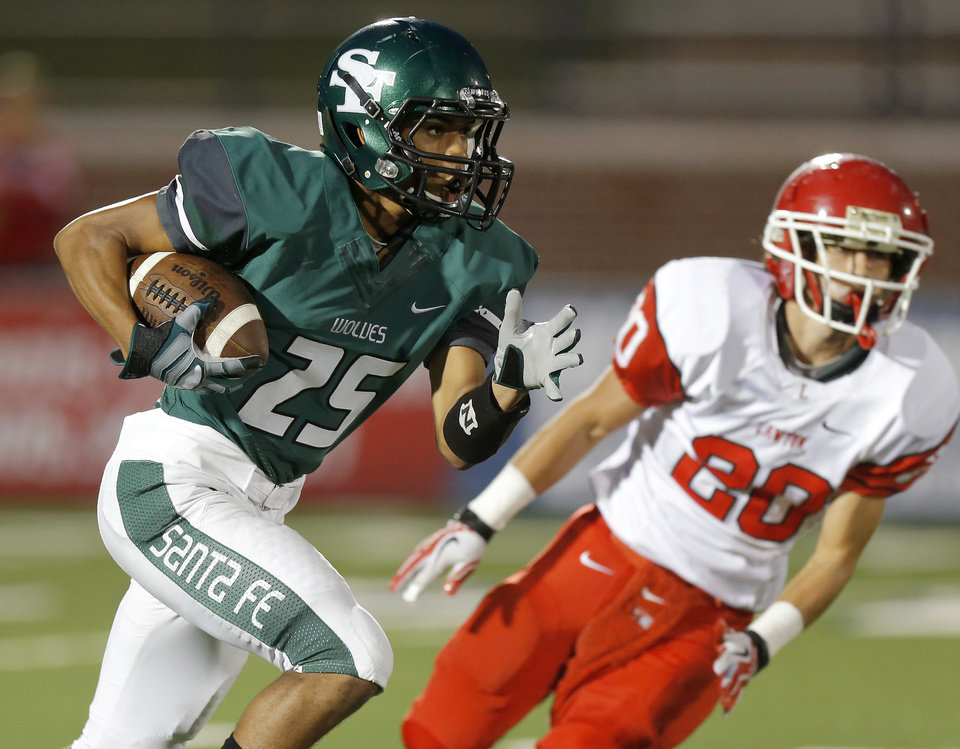 Photo - Edmond Santa Fe's Dale Jefferson runs past Lawton's Casey Nadeau during their high school football game at Wantland Stadium in Edmond, Okla., Thursday, October 11, 2012. Photo by Bryan Terry, The Oklahoman