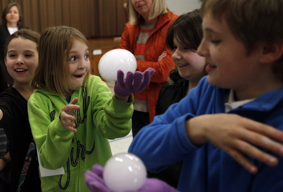 Jaiden Knight holds a frozen soap bubble during Science Night for Kids at Wilson Elementary School.