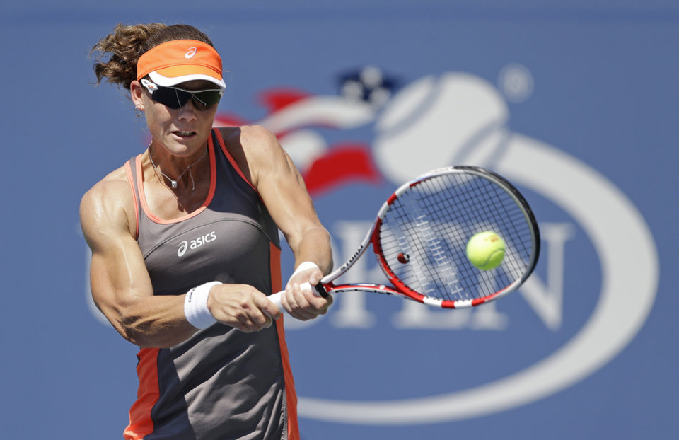 Photo -   Samantha Stosur, of Australia, returns a shot to Varvara Lepchenko in the third round of play at the 2012 US Open tennis tournament, Friday, Aug. 31, 2012, in New York. Stosur won the match. (AP Photo/Mike Groll)