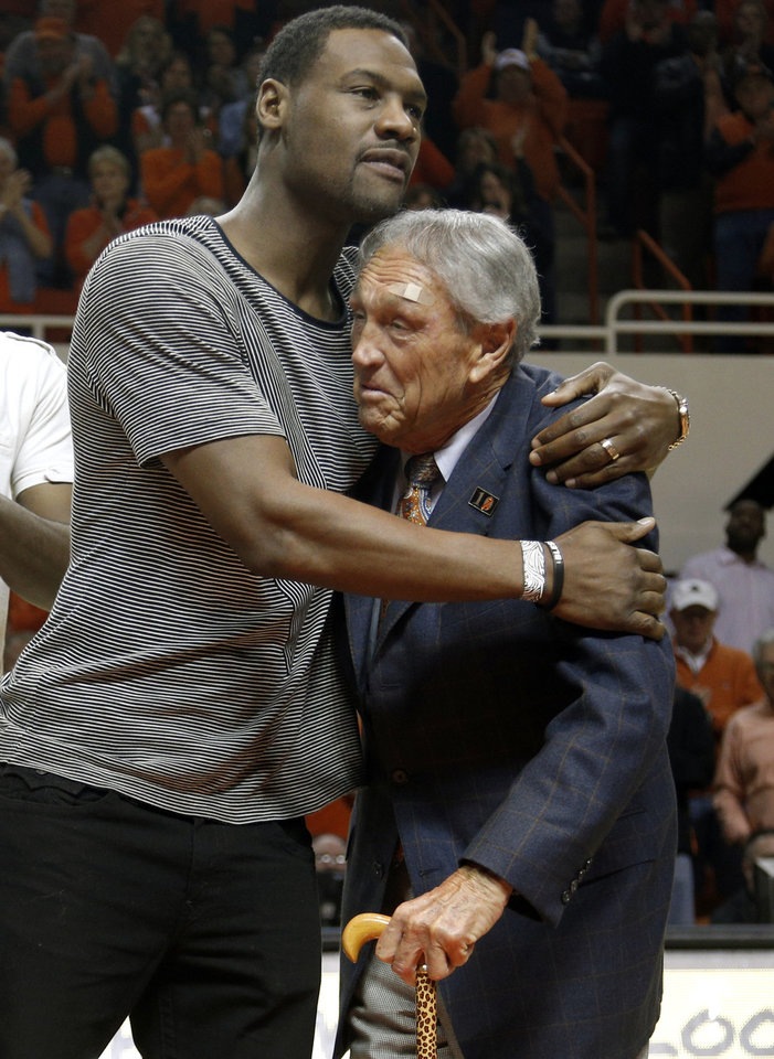 Photo - Former OSU basketball player Tony Allen hugs coach Eddie Sutton during the men's Bedlam college game between Oklahoma and Oklahoma State at Gallagher-Iba Arena in Stillwater, Okla., Saturday, Feb. 15, 2014. Members of the OSU 2004 Final Four team were honored at halftime. Photo by Sarah Phipps, The Oklahoman