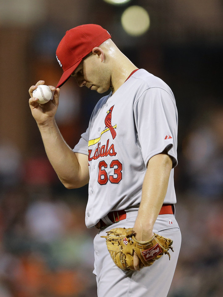 Photo - St. Louis Cardinals starting pitcher Justin Masterson pauses in the third inning of an interleague baseball game against the Baltimore Orioles, Friday, Aug. 8, 2014, in Baltimore. Masterson was removed in the third inning. (AP Photo/Patrick Semansky)
