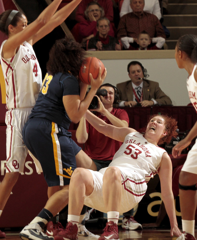 Photo - Oklahoma Sooner's Joanna McFarland (53) draws a charge on West Virginia Mountaineers' Ayana Dunning (33) as the University of Oklahoma Sooners (OU) play the West Virginia Mountaineers in NCAA, women's college basketball at The Lloyd Noble Center on Wednesday, Jan. 2, 2013  in Norman, Okla. Photo by Steve Sisney, The Oklahoman