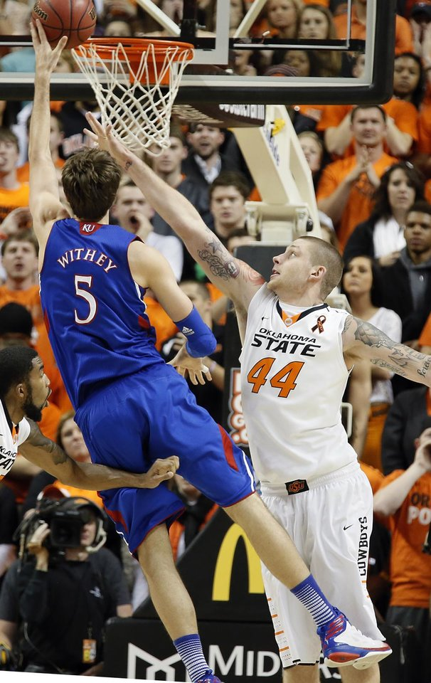 Photo - Oklahoma State 's Philip Jurick (44) defends on Kansas' Jeff Withey (5) during the college basketball game between the Oklahoma State University Cowboys (OSU) and the University of Kanas Jayhawks (KU) at Gallagher-Iba Arena on Wednesday, Feb. 20, 2013, in Stillwater, Okla. Photo by Chris Landsberger, The Oklahoman