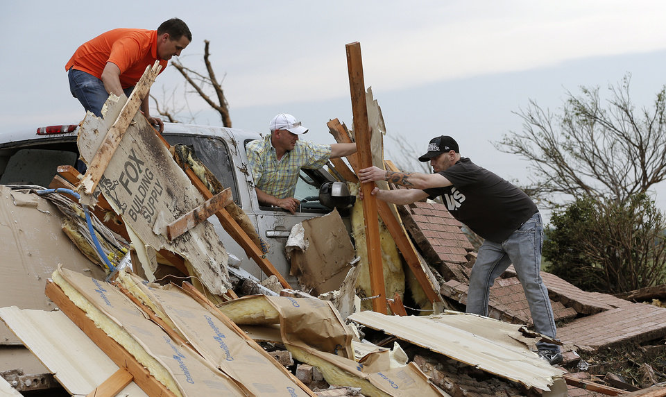 Volunteers help uncover a truck after the tornado hit the area near 149th and Drexel on Monday, May 20, 2013 in Oklahoma City, Okla.  Photo by Chris Landsberger, The Oklahoman