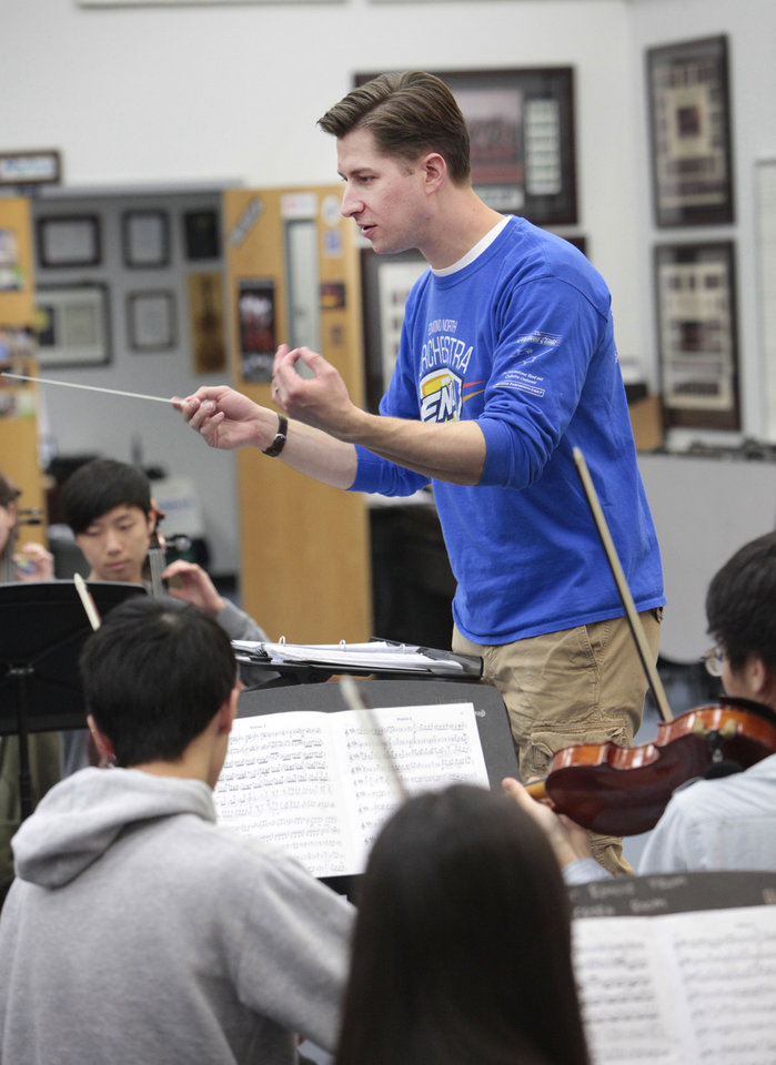 Peter Markes teaches his orchestra students at Edmond North High School.