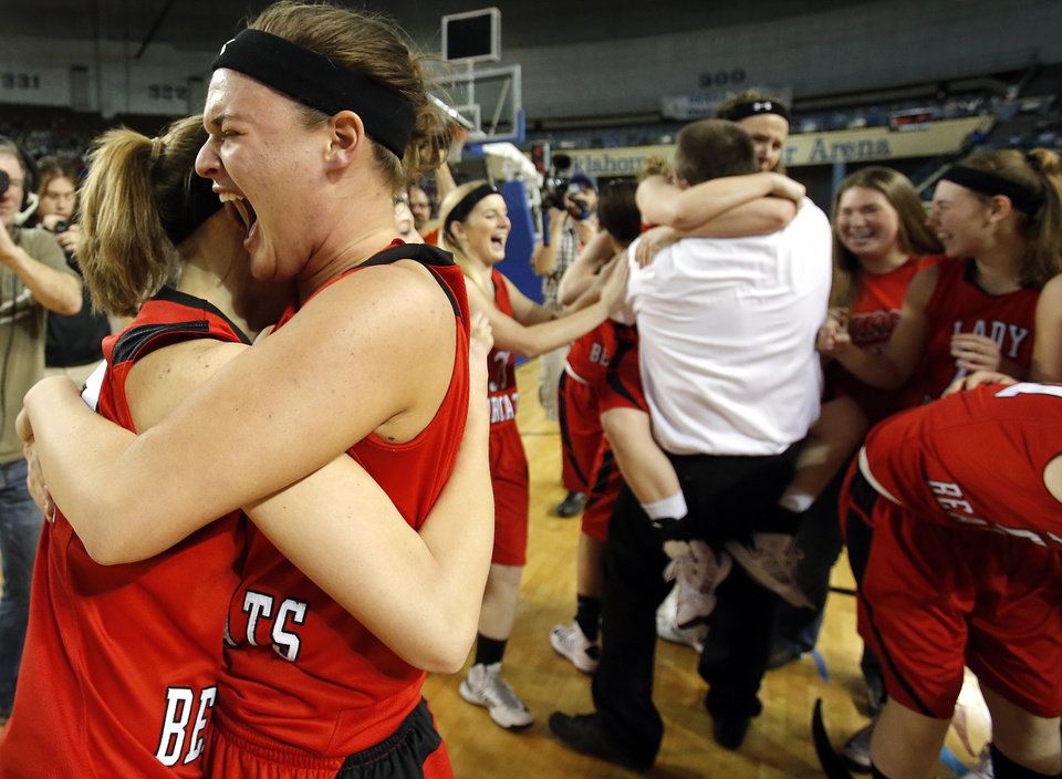 Erick's Emily Carpenter, right, hugs Makenzie Kelly after winning Class B girls state championship over Lomega at the State Fair Arena.,  Saturday, March 2, 2013. Photo by Sarah Phipps, The Oklahoman