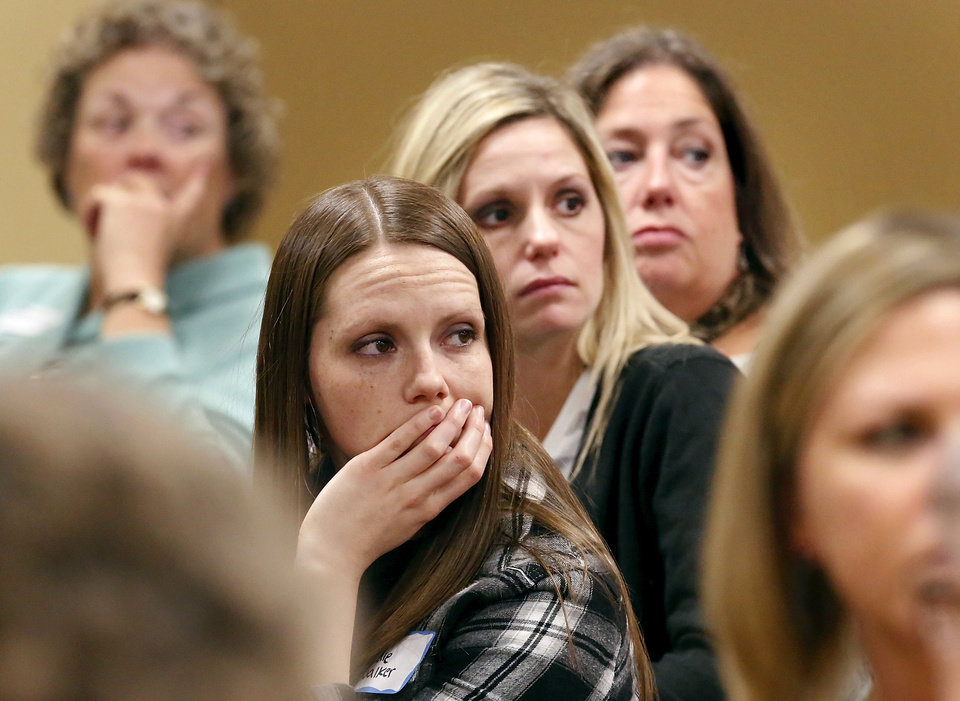 Photo - Audie Walker, front, Michelle Wells, center, and Debbie Barnes listen to a fellow child care provider address the panel. The women  are with the Camelot Child Development Center in Edmond.  About 200  child care providers attended a public forum at Francis Tuttle Technology Center, Reno campus, to  voice their concerns with DHS regulators during a 2-hour session Tuesday afternoon, Nov. 27, 2012.  Photo by Jim Beckel, The Oklahoman
