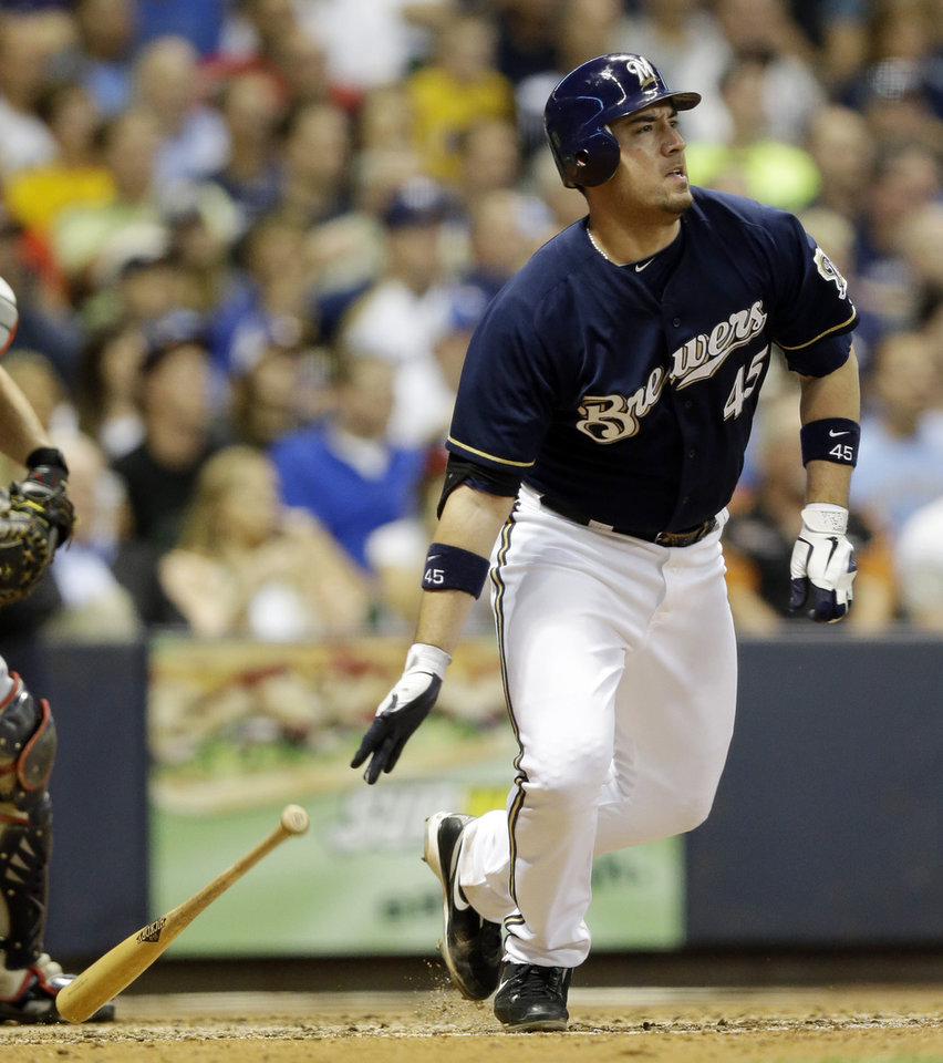 Photo -   Milwaukee Brewers' Travis Ishikawa hits a three-run scoring double during the fifth inning of a baseball game against the Atlanta Braves, Wednesday, Sept. 12, 2012, in Milwaukee. (AP Photo/Morry Gash)