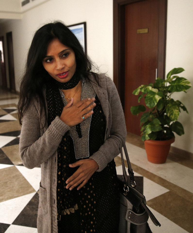 Photo - Devyani Khobragade, who served as India's deputy consul general in New York, greets journalists as she leaves Maharastra Sadan state house in New Delhi, India, Saturday, Jan. 11, 2014. Khobragade, 39, is accused of exploiting her Indian-born housekeeper and nanny, allegedly having her work more than 100 hours a week for low pay and lying about it on a visa form. Khobragade has maintained her innocence, and Indian officials have described her treatment as barbaric. (AP Photo/Saurabh Das)