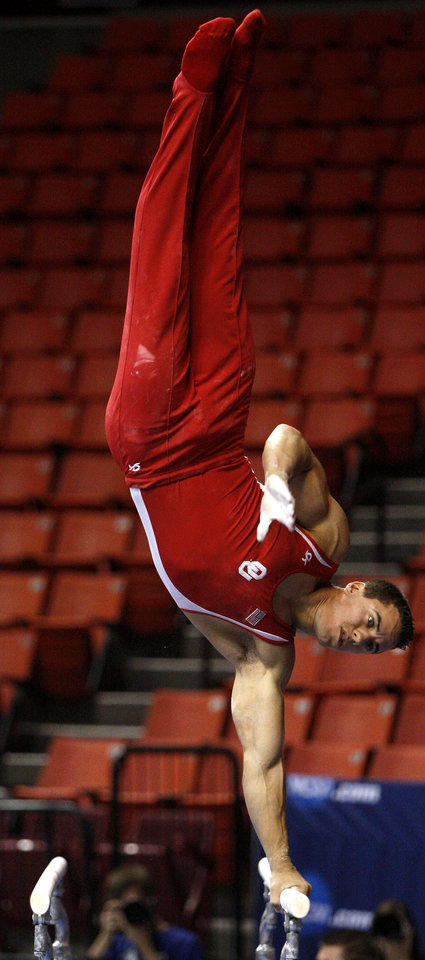 Photo - Oklahoma's Jake Dalton competes on the parallel bars during the men's NCAA college gymnastics championships in at the Lloyd Noble Center in Norman, Okla., Thursday, April19, 2012. Photo by Bryan Terry, The Oklahoman