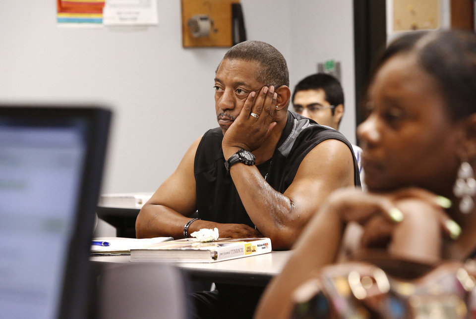 Photo - Anthony Scott sits among younger students in a class at Rose State College on Thursday. July 25, 2013. In foreground is student Shawntah Henderson. Photo by Jim Beckel, The Oklahoman.  Jim Beckel - THE OKLAHOMAN