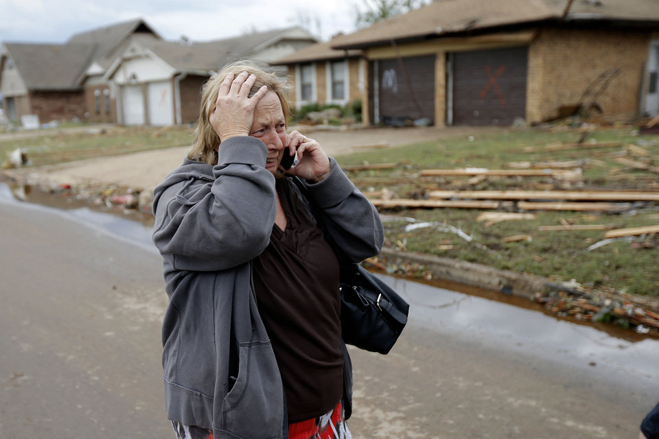 Paula McGee reacts as she sees her home on Kings Manor in Moore, Okla., on Tuesday, May 21, 2013. McGee bought the house two weeks ago and it was hit by the tornado that moved through the Moore area on Monday. Photo by Bryan Terry, The Oklahoman