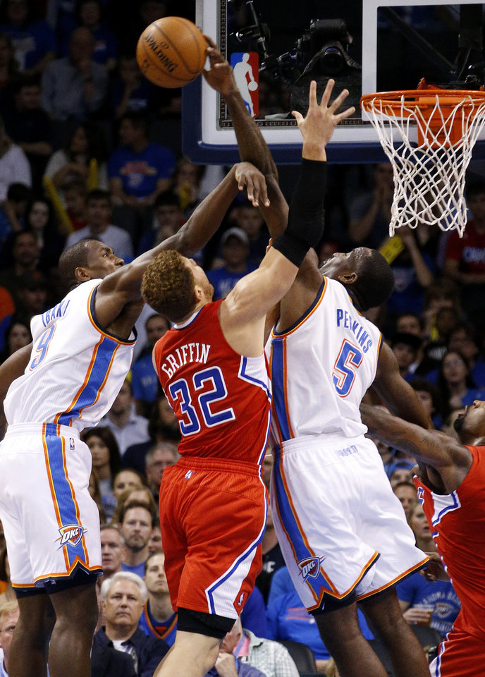 Oklahoma City\'s Serge Ibaka (9) and Kendrick Perkins (5) defend the Clippers Blake Griffin (32) during an NBA basketball game between the Oklahoma City Thunder and the Los Angeles Clippers at Chesapeake Energy Arena in Oklahoma City, Wednesday, Nov. 21, 2012. Photo by Bryan Terry, The Oklahoman