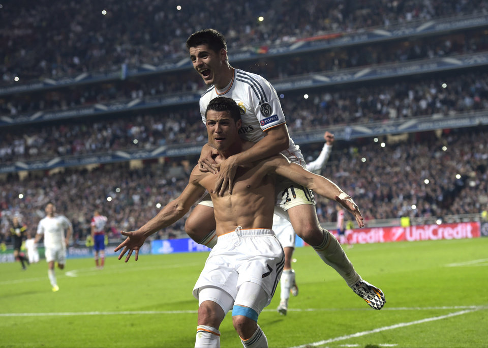 Photo - Real's Cristiano Ronaldo, foreground and Real's Alvaro Morata react, at the end of the Champions League final soccer match between Atletico Madrid and Real Madrid, at the Luz stadium, in Lisbon, Portugal, Saturday, May 24, 2014. (AP Photo/Manu Fernandez)