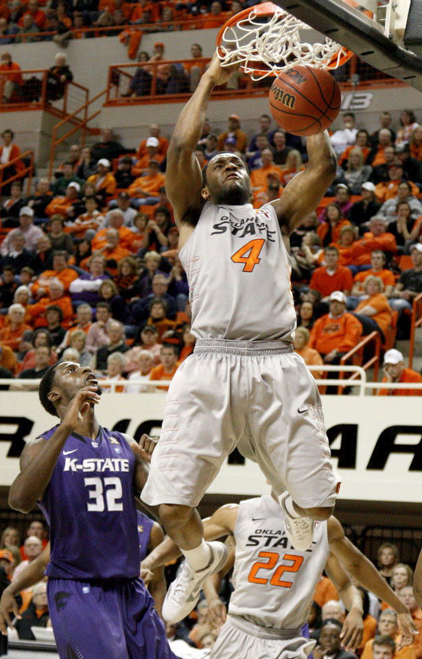Photo - Oklahoma State's Brian Williams (4) dunks the ball beside Kansas State's Jamar Samuels (32) during an NCAA college basketball game between the Oklahoma State University Cowboys (OSU) and the Kansas State University Wildcats (KSU) at Gallagher-Iba Arena in Stillwater, Okla., Saturday, Jan. 21, 2012. Photo by Bryan Terry, The Oklahoman