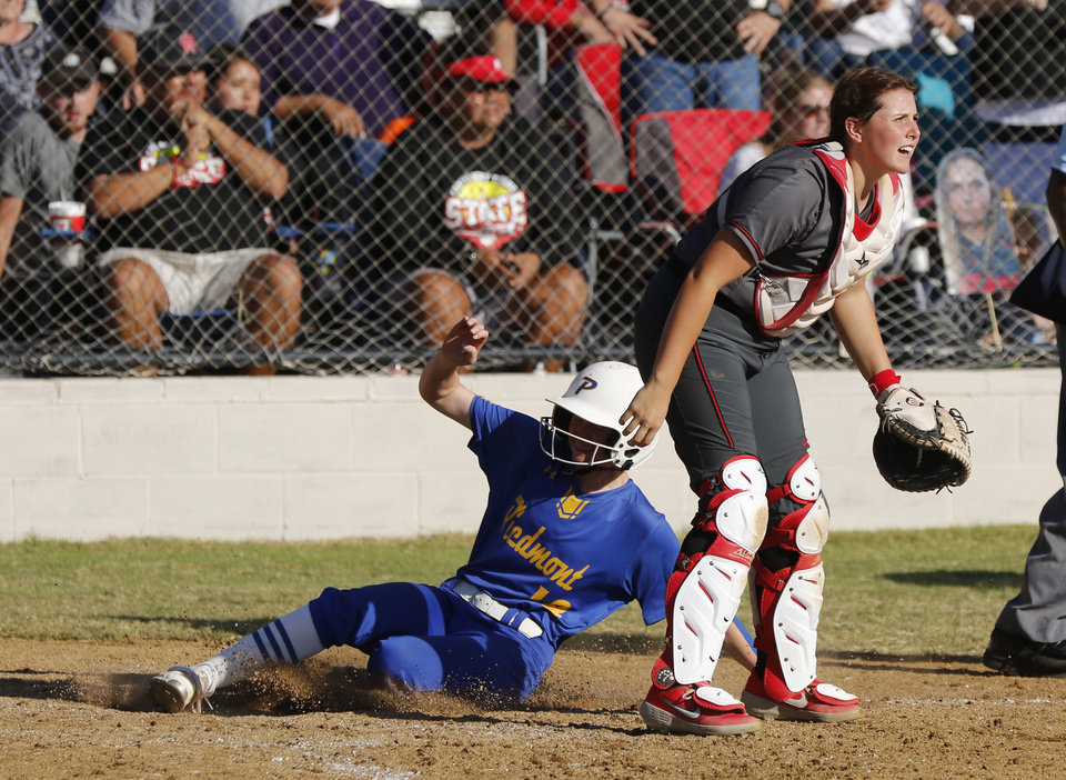 Photo - PHS #18 Ashlyn Brown scores the winning run past CAHS #9 Zadie Lavalley during the 5A Fast Pitch Championship game between Piedmont and Carl Albert at the Ball Fields at Firelake in Shawnee, Saturday, October 19, 2019. [Doug Hoke/The Oklahoman]