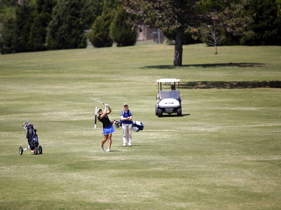CLASS 2A GIRLS HIGH SCHOOL GOLF / STATE TOURNAMENT: A golfer hits her ball from the fairway on the back nine during Class 2A girls golf state championship tournament at Trosper Park Golf Course in Oklahoma City on Wednesday,  May 1, 2013.     Photo  by Jim Beckel, The Oklahoman.