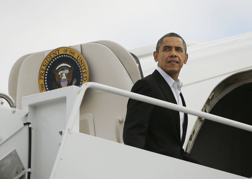 President Barack Obama is seen boarding Air Force One before his departure from Andrews Air Force Base, Saturday, Nov. 3, 2012. Obama traveling for the campaign events in Ohio, Wisconsin, Iowa and Virginia today. (AP Photo/Pablo Martinez Monsivais)