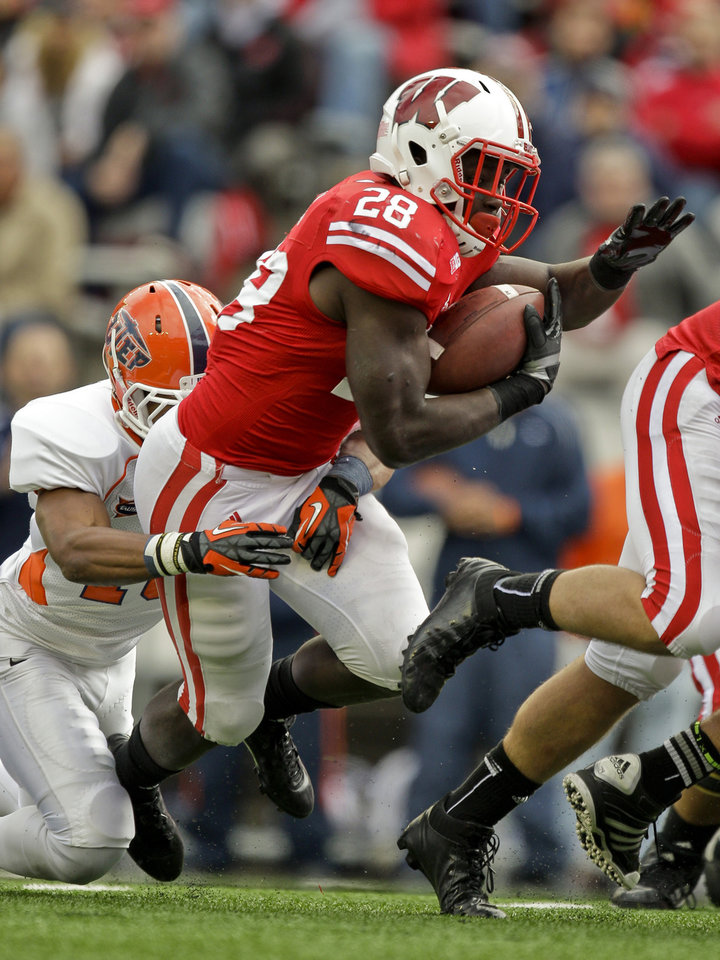 Photo -   Wisconsin running back Montee Ball is tacked near the goal line by UTEP linebacker A.J. Ropati during the first half of an NCAA college football game, Saturday, Sept. 22, 2012, in Madison, Wis. (AP Photo/Andy Manis)