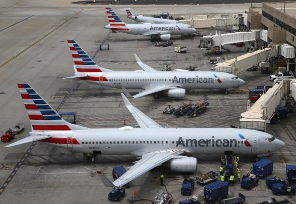 Photo -  American Airlines planes are shown at Phoenix Sky Harbor International Airport in Phoenix.  [AP PHOTO]