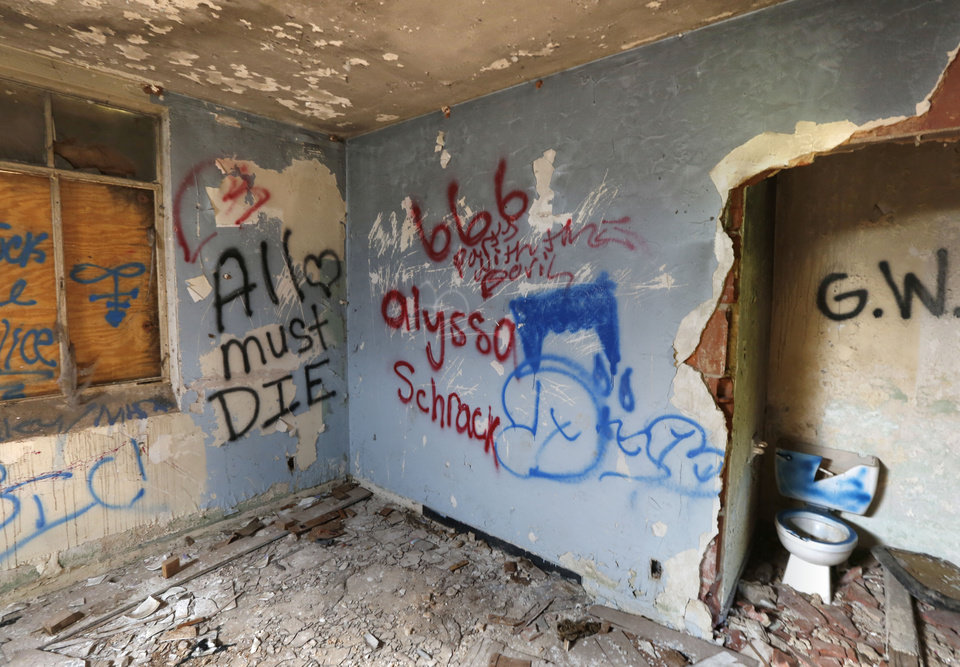 Photo -  Grafitti is spread across walls and ceilings that are falling down at St. Vincent's Home in northeast Oklahoma City. [Photo by Paul Hellstern, The Oklahoman]