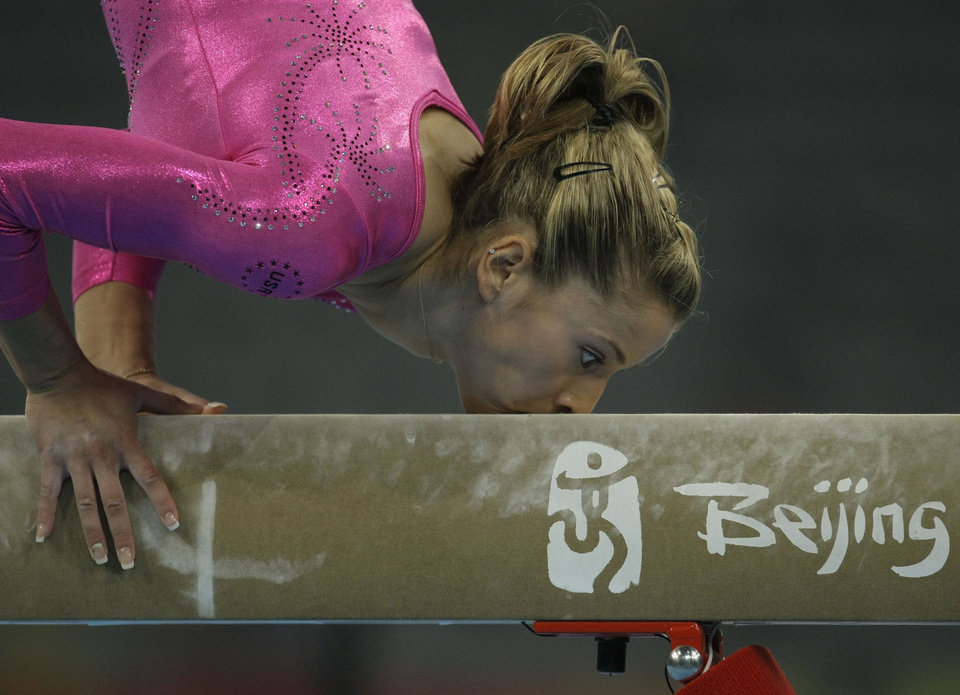 Photo - U.S. gymnast Alicia Sacramone performs at the balance beam during a podium training ahead of the Beijing 2008 Olympics in Beijing, Thursday Aug. 7, 2008.  (AP Photo/Matt Dunham) ORG XMIT: OLYGY320