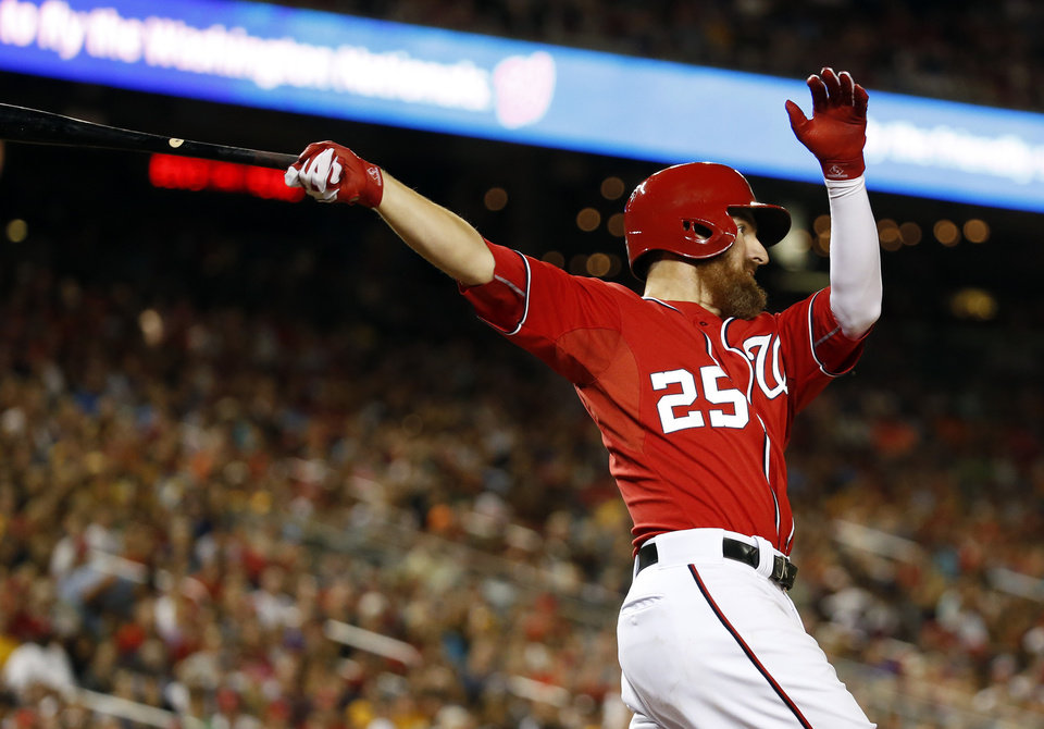Photo - Washington Nationals' Adam LaRoche follows through on his two-run homer during the eighth inning of a baseball game against the Pittsburgh Pirates at Nationals Park, Saturday, Aug. 16, 2014, in Washington. The Nationals won 4-3. (AP Photo/Alex Brandon)