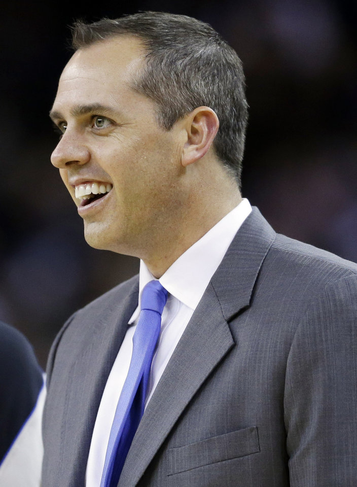 Photo - Indiana Pacers coach Frank Vogel smiles as his team play the Golden State Warriors during the first half of an NBA basketball game in Oakland, Calif., Saturday, Dec. 1, 2012. (AP Photo/Marcio Jose Sanchez)