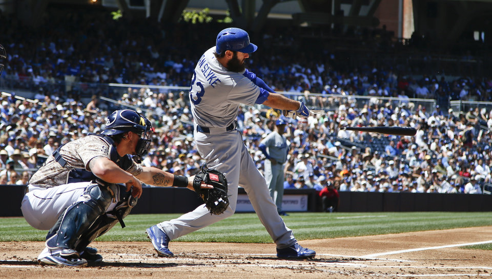 Photo - Los Angeles Dodgers' Scott Van Slyke breaks his bat while hitting a bloop single to drive in a run in the first inning of a baseball game against the San Diego Padres, Sunday, Aug. 31, 2014, in San Diego. (AP Photo/Lenny Ignelzi)