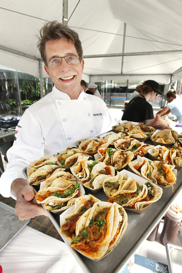Photo - Chef Rick Bayless shows off a tray of fresh grilled tacos served at Leadership Square for OK Chefs Relief on Monday.  PAUL B. SOUTHERLAND - PAUL B. SOUTHERLAND