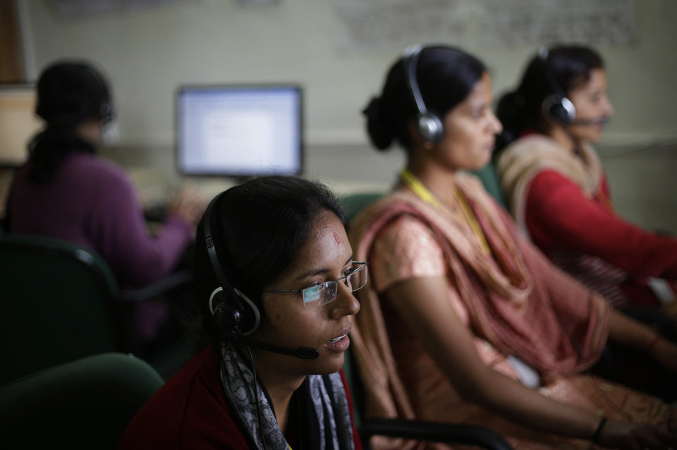 Photo -   In this Aug. 23, 2012 photo, employees use headsets as they work on computers at the B2R center in Simayal, India. Before B2R arrived in Simayal, local women had little option but to marry right out of school, and educated young men had to travel far to seek respectable jobs. (AP Photo/Saurabh Das)