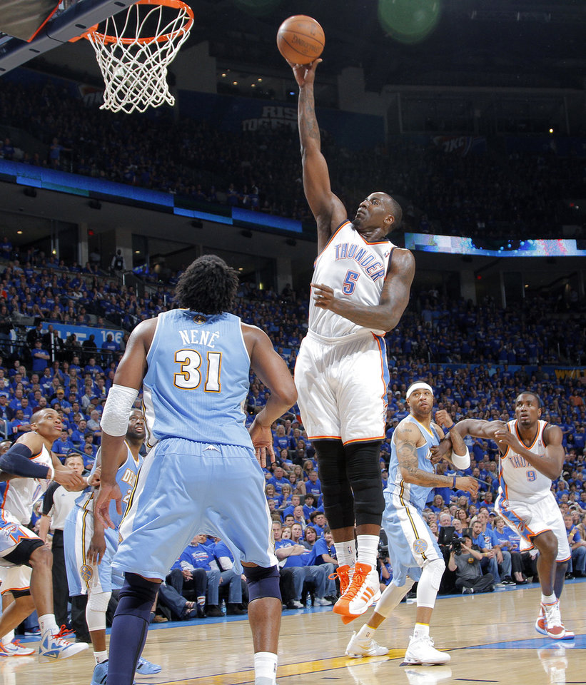 Oklahoma City's Kendrick Perkins (5) puts up a shot in front of Denver's Nene (31) during the first round NBA playoff game between the Oklahoma City Thunder and the Denver Nuggets on Sunday, April 17, 2011, in Oklahoma City, Okla. Photo by Chris Landsberger, The Oklahoman