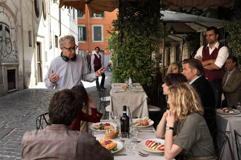 Photo -   This film image released by Sony Pictures Classics shows director Woody Allen, standing left, talking with the cast during the filming of