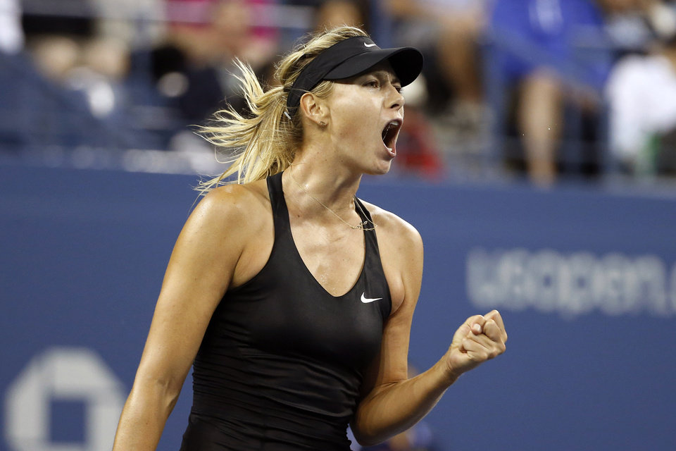 Photo - Maria Sharapova, of Russia, reacts after winning a game against Sabine Lisicki, of Germany, during the third round of the U.S. Open tennis tournament Friday, Aug. 29, 2014, in New York. (AP Photo/Jason DeCrow)