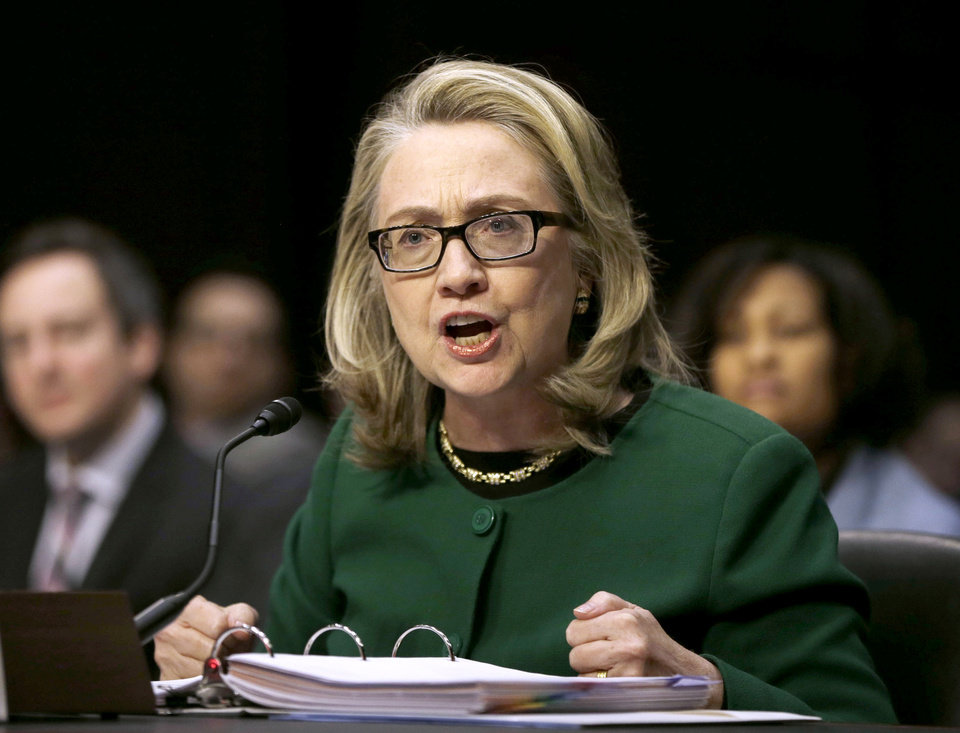 Photo - FILE - This Jan. 23, 2013 file photo shows then-Secretary of State Hillary Rodham Clinton testifying on Capitol Hill in Washington before the Senate Foreign Relations Committee hearing on the deadly September attack on the U.S. diplomatic mission in Benghazi, Libya, that killed Ambassador Chris Stevens and three other Americans.  To congressional Republicans,
