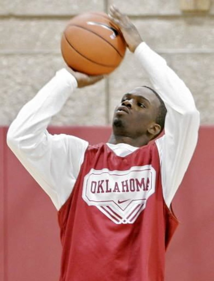 Photo -  Willie  Warren warms up before practice at the Lloyd Noble Center on the campus of the University of Oklahoma in Norman on Monday, Feb. 15, 2010. Photo by John Clanton
